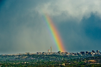 Al Jazeera feature on the Ponte Building and surrounding areas in Johannesburg CBD, South Africa. A rainbow over the Johannesburg skyline. Ponte is part of that skyline (in the centre) Johannesburg is called Egoli: Place of Gold and the rainbow is symbolic of the pot of gold at the end of a rainbow. . Picture: Cornel van Heerden/Al Jazeera
