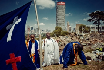 Al Jazeera feature on the Ponte Building and surrounding areas in Johannesburg CBD, South Africa. Prayers of the Christian faith, pray on Yeoville-koppies. Ponte can be seen in the background . Picture: Cornel van Heerden/Al Jazeera