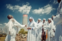 Al Jazeera feature on the Ponte Building and surrounding areas in Johannesburg CBD, South Africa. Prayers of the Christian faith, pray on Yeoville-koppies. Ponte can be seen in the background. Here they get cleansed by holy water. . Picture: Cornel van Heerden/Al Jazeera