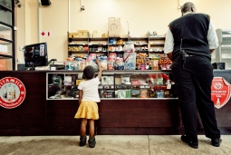 Al Jazeera feature on the Ponte Building and surrounding areas in Johannesburg CBD, South Africa. A little girl reaches for sweets in the butchery/supermarket, inside Ponte. . Picture: Cornel van Heerden/Al Jazeera