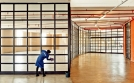 Al Jazeera feature on the Ponte Building and surrounding areas in Johannesburg CBD, South Africa. A cleaner cleans the windows of some of the empty shops in Ponte. . Picture: Cornel van Heerden/Al Jazeera