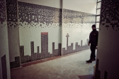 Al Jazeera feature on the Ponte Building and surrounding areas in Johannesburg CBD, South Africa. A security guard walks past tiles against the wall depicting the Johannesburg skyline. . Picture: Cornel van Heerden/Al Jazeera