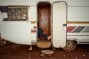 Al Jazeera feature on the Ponte Building and surrounding areas in Johannesburg CBD, South Africa. A local shop owner sits with his foot holding the door open of a caravan. He sells his goods from there. . Picture: Cornel van Heerden/Al Jazeera